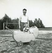 Vintage photo of young father with baby daughter (fifties)