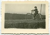 Vintage photo of a boy cycling (1938)