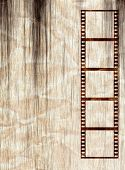 Film strip on a grunge creased paper