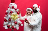 Happy Family In Santa Hats Decorating Christmas Tree. Family, Love, X-mas, Winter Holiday - Happy Hu poster