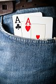 Two aces in a jeans trousers pocket