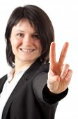 Young woman showing the victory sign