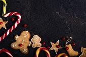 New Year And Christmas Background. Christmas Candy Cane  Gingerbread On Black Background. New Year A poster