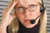 Businesswoman With Phone Headset Has Headache