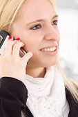 Young woman talking at the mobile phone