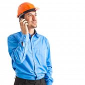 Engineer on the phone isolated on white