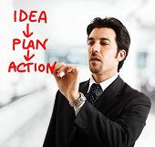 Portrait of a businessman writing an action plan on the screen