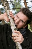 image of fidget  - Picture of a man who gnaw their teeth wood - JPG