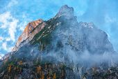 Panorama Of Dachstein Mountains Peaks With Sunset Light Austria. Peaks Covered With Clouds. Location poster