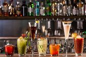 Alcohol Bar, Cocktail Glass On Bar Counter, Cocktail Glass In A Bar, Drinking Cocktails poster