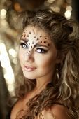 The image of a beautiful girl with an unusual make-up as a leopard