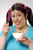 Fat woman holding a cereal bowl,woman eating cereal,