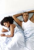 Afro american couple on bed.