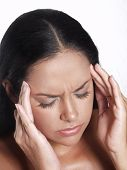 Latin woman suffering from headache on white background.