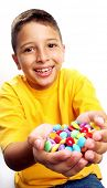 Little boy eating candy on white background. Little boy eating chicle. Little boy holding candies on