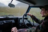 Man driving an old SUV in the Highlands poster