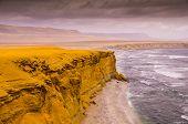 Yellow Cliffs At Paracas National Reserve In Peru: The Coastal Desert Landscape Of Paracas National  poster