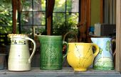 Four Old Ceramic Pitchers