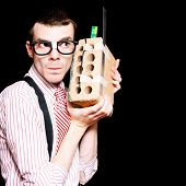 Male Nerd Inventor Holding Brick Mobile Telephone