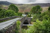 Bridge Over Small River At Grange In Lake District