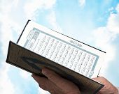 stock photo of quran  - A Muslim Male Hands with Quran over Blue Sky - JPG