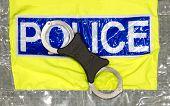 Police Handcuffs On A Hi Visibilty Jacket