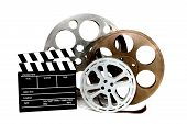 Movie Production Clapper And Film Tins On White