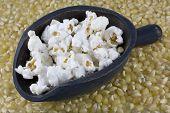 Wooden Scoop Of Popcorn And Corn Kernels