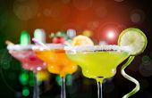 image of vodka  - Fruit cocktails on black background - JPG