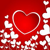 Love concept with heart shape on red background.