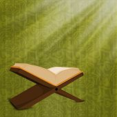 Open Islamic religious holy book Quran Shareef on green background.