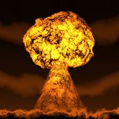 pic of nuclear bomb  - Nuclear mushroom rising over land - JPG