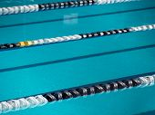 stock photo of swim meet  - Swimming lane ropes in competition pool venue - JPG