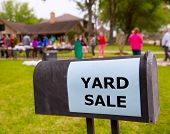 stock photo of yard sale  - Yard sale in an american weekend on the green lawn - JPG