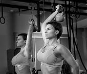 Crossfit fitness weight lifting Kettlebell woman at mirror workout exercise at gym