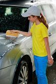 Carwash - young girl helping in carwash