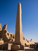 Tourists stand beside a obelisk at Karnak temple, Luxor, Egypt
