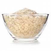rice in glass bowl close up isolated on white background