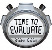 The words TIme to Evaluate on a stopwatch or timer to illustrate assessment, evlauation, grading, re