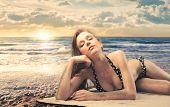 beautiful woman in bikini sunbathing at the beach