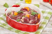 stock photo of giblets  - Raw chicken liver in heart shaped bowl. Macro, close up ** Note: Shallow depth of field - JPG