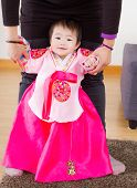 Traditional korean costume baby try to stand up