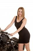 Woman Black Dress And Motorcycle Handlebars Looking