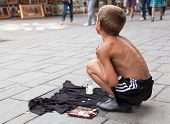 SARAJEVO, BOSNIA AND HERZEGOVINA - AUG 11: Sevdalija Osmanovic, 10 years old, sings on street to byp