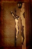 stock photo of crucifiction  - Sculpture of Jesus on the cross with shadow on the wall - JPG