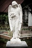 Statue of angel in old cemetery Museum Prasasti