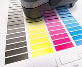 stock photo of dtp  - Printing colour charts for measuring colour values and control in printing industry using a spectrometer - JPG