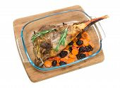 Roasted Leg Of Lamb With Prunes And Carrots On A White Background