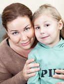 Caucasian Mother Face To Face With Preschooler Daughter