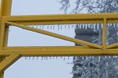foto of freezing temperatures  - Icicles formed on bars after an ice storm and freezing temperature hit the city - JPG